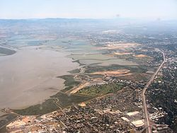 An aerial image of East Palo Alto, looking southeast towards Mountain View, California