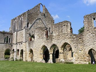 Netley Abbey - The cloister showing the south transept of the church and the east range. The triple arches in the centre are the entrance to the chapter house.