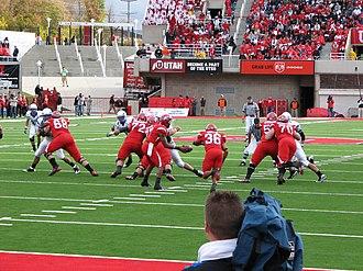 2009 Utah Utes football team - Quarterback Terrance Cain hands the ball to running back Eddie Wide