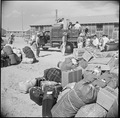 Eden, Idaho. Baggage, belonging to evacuees from the assembly center at Puyallup, Washington, is so . . . - NARA - 538277.tif