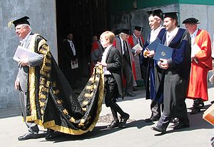 Academic dress of the University of Oxford - Encaenia Procession: The Chancellor (with trainbearer) immediately followed by the University Proctors and others