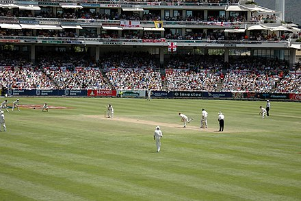 A Test match between South Africa and England in January 2005. The men wearing black trousers are the umpires. Teams in Test cricket, first-class cricket and club cricket wear traditional white uniforms and use red cricket balls. England vs South Africa.jpg