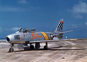 "John Glenn - Glenn's USAF F-86F, dubbed ""MiG Mad Marine"", during the Korean War in 1953. The names of his wife and children are also written on the aircraft."