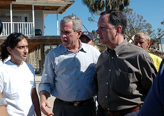 Timeline of the George W. Bush presidency (2004) - President George W. Bush and Department of Homeland Security Under Secretary Michael Brown talk with residents affected by Hurricane Ivan on September 19, 2004.