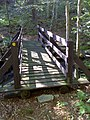 FLT M33 0.5 mi - Bridge over Black Brook, 4' wide, 25' long, 2x8s deck, tel pole stringers, 6x6 hand rail posts, 1x6 rails, 5.5' to drainage - panoramio.jpg