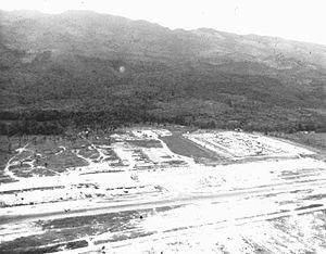 Aerial photo of Dak To looking toward Laos, Vi...