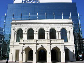 National Theatre Bucharest - The front of the Bucharest Novotel, on Calea Victoriei in 2010, replicates the exterior of the old Romanian National Theatre approximately in its original location