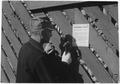 Farmer nails Ever Normal Granary sign on his corn crib - NARA - 195851.tif