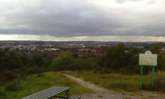 "Fenton, Staffordshire - The Fenton skyline, mostly a residential area, with a prominent church (Christ Church) being a notable feature. As taken on a cloudy day in August, 2010, atop Glebedale Park Hill.   This latter was immortalized in music in 2010, in a work for full symphony orchestra, written by local violinist, pianist, and composer, Vic Carnall, and entitled, ""Glebedale Park Hill"", which, with an orchestra of 100 players, received its première performance at The Victoria Hall, Hanley, Stoke-on-Trent, on the 6th of November, 2010, as part of the centenary celebrations of Stoke-on-Trent's Federation in 1910."