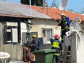 Israel Fire and Rescue Services - Israeli firefighters extinguish a fire in Ramat HaSharon