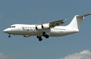 Flightline - A Flightline BAe 146-300 landing at Heathrow Airport, England. (2004)