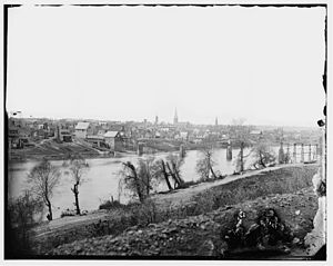 Fredericksburg, Virginia - Fredericksburg, Virginia, March 1863. View from across the Rappahannock River. To the right is the steeple of Fredericksburg Baptist Church, and toward the center is the tower of St. George's Church. To the left of center are two mill buildings of the manufacturing district.