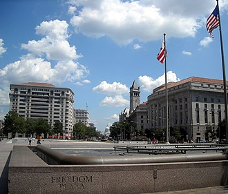 Freedom Plaza - Looking southeast across Freedom Plaza towards Pennsylvania Avenue and the Old Post Office Building, with the United States Capitol in the background. (2008)