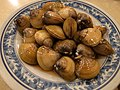 Fresh water clam with garlic soy sauce (5674216606).jpg