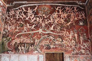 Preserved wall painting of 1802 depicting the Hell,[85][86][87] by the Peruvian mestizo painter Tadeo Escalante, inside the Church of San Juan Bautista in Huaro, Peru. The church's interior is full of wall paintings.