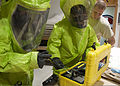 From left, U.S. Air Force Airmen 1st Class Eric Welsh and William Workman use a hazardous materials identifier on a simulated hazardous substance while Staff Sgt. Brandon Barnes evaluates their actions during 130306-F-KZ210-004.jpg