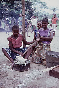 Young women preparing fufu