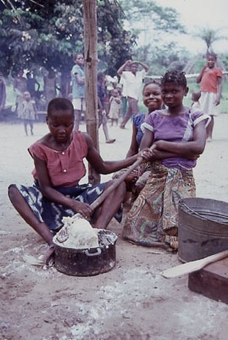 Demographics of the Democratic Republic of the Congo - Young women preparing fufu.