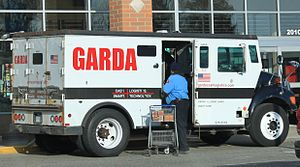 Armored car (valuables) - An armored Garda car, in Ypsilanti Township, Michigan