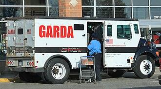 Armored car (valuables) - An armored Garda car, in Ypsilanti Township, Michigan