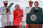 Gen. Colin L. Powell, left, first lady Barbara Bush and Adm. Charles R. Larson applaud as President George Bush finishes a speech during the observance of the 50th anniversary of the Japanese attack on Pearl Harbor.jpg