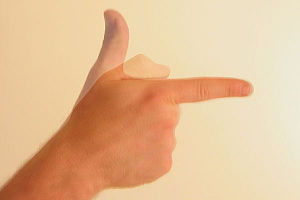 Finger gun - Image: Gesture thumb up then down forefinger out like gun