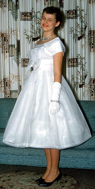 Formal wear - Girl in formal dress for prom night, USA, 1950s.