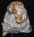 Gold-quartz hydrothermal vein (deep subsurface gold mine at Witwatersrand, South Africa) (16844684440).jpg