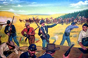 9th Infantry Regiment (United States) - Near Fort Phil Kearney, Wyoming, 2 August 1867. The Wagon Box Fight is one of the great traditions of the Infantry in the West. A small force of 30 men on the 9th Infantry led by Brevet Major James Powell was suddenly attacked in the early morning hours by some 2,000 Sioux Indians. Choosing to stand and fight, these soldiers hastily erected a barricade of wagon boxes, and during the entire morning stood off charge after charge. The Sioux finally withdrew, leaving behind several hundred killed and wounded. The defending force suffered only three casualties. By their coolness, firmness and confidence these infantrymen showed what a few determined men can accomplish with good marksmanship and guts.