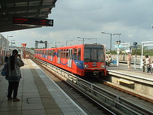 Docklands Light Railway - DLR platforms at Greenwich, a northbound train approaching; view from southbound platform