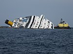 Grounded and partially capsized Cruise ship Costa Concordia and the Ocean Crane Barge Meloria - 12 Feb. 2012 - (1).jpg