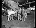 "Group next to airplane with package addressed to ""Dr. Hugo Eckener, Graf-Zeppelin, Lakehurst, N.J. LCCN2016889067.jpg"