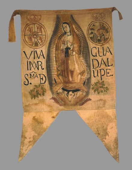 Banner with the image of the Virgin of Guadalupe carried by Hidalgo and his insurgent militia. Liberal bishop-elect Manuel Abad y Queipo denounced the insurgents' use of her image as a sacrilege. Guadalupano.jpg