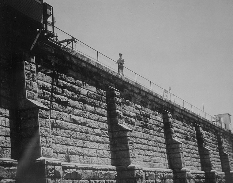 File:Guard patrols atop Central Prison (State Prison) wall, Raleigh, NC, no date (c.1950-1960's). State Archives of North Carolina, Raleigh, NC. (28891475785).jpg
