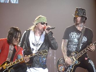 Richard Fortus - Fortus (left) with Guns N' Roses singer Axl Rose and guitarist DJ Ashba in 2011.