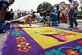 Guys preparing sawdust carpet for Semana Santa in Antigua, Guatemala.JPG