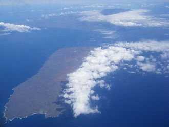 Kahoolawe - Aerial photo of Kahoʻolawe. In the background is Mount Haleakala on Maui.