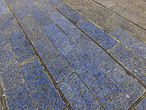 Blue Carpet - The tiles have rapidly faded to a blue-grey colour, a fact that is made more obvious when damaged tiles are replaced with those of the original colour