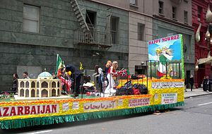 Azerbaijani population - Iranian Azerbaijani-Americans in Nowruz celebration parade on a cloudy afternoon.