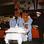 He Apollo 9 crew prepares to cut the 350-pound cake which was baked on the U.S.S. Guadalcanal in their honor.jpg