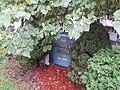 Hilda Crockett's Chesapeake House, sign hidden by foliage.jpg