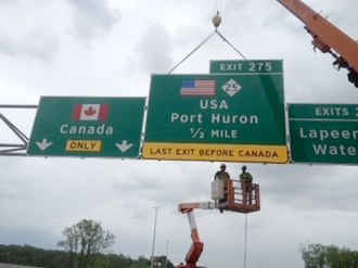Interstate 69 in Michigan - New signage being erected in 2011 to reflect a reconfigured interchange near the Blue Water Bridge in Port Huron