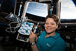 ISS-58 Anne McClain with biomedical gear inside the Cupola.jpg
