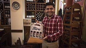 İbrahim Doğuş - İbrahim Doğuş at Troia restaurant with a sample of his Bira beer