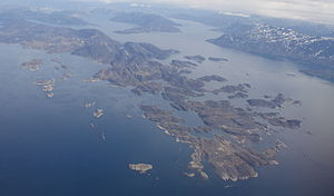 Ikertooq Fjord - Aerial view of Sallersuaq island and skerries at the mouth of Ikertooq Fjord.