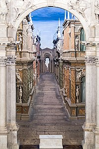 Interior of Teatro Olimpico (Vicenza)- Scaenae frons close-up - La porta regia.jpg