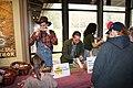 Intern Zack Curtis, Ranger Katie Corrigan, and intern Dominique Sanchez assist visitors with crafts at the 2018 Festival of Christmas Past, December 8, 2018--Warren Bielenberg (46080028315).jpg