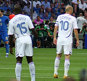 Lilian Thuram - Thuram (left) alongside Zinedine Zidane, playing for France in the 2006 FIFA World Cup Final.