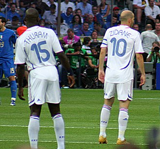 Lilian Thuram - Thuram (left) alongside Zinedine Zidane, playing for France in the 2006 FIFA World Cup Final.