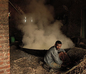 Jaggery - Jaggery preparation by heating juice in the vessel on furnace